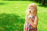 Girl got ready to blow on dandelions — Stock Photo