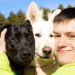 Royalty-Free Stock Photo: Friends. Man and two his dogs.