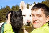 Friends. Man and two his dogs. — Stock Photo