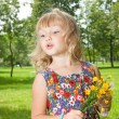 Stock Photo: Girl with flowers