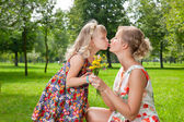 Girl kissing her mother — Stock Photo