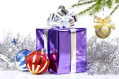 Box with Christmas gift and decorations — Stock Photo