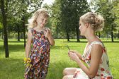 Girl gives a flowers mother — Stock Photo