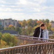 Stock Photo: Romantic couple kissing in autumn park