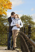 Romantic couple kissing in autumn park — Stok fotoğraf