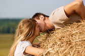 Young couple kissing — Stock Photo