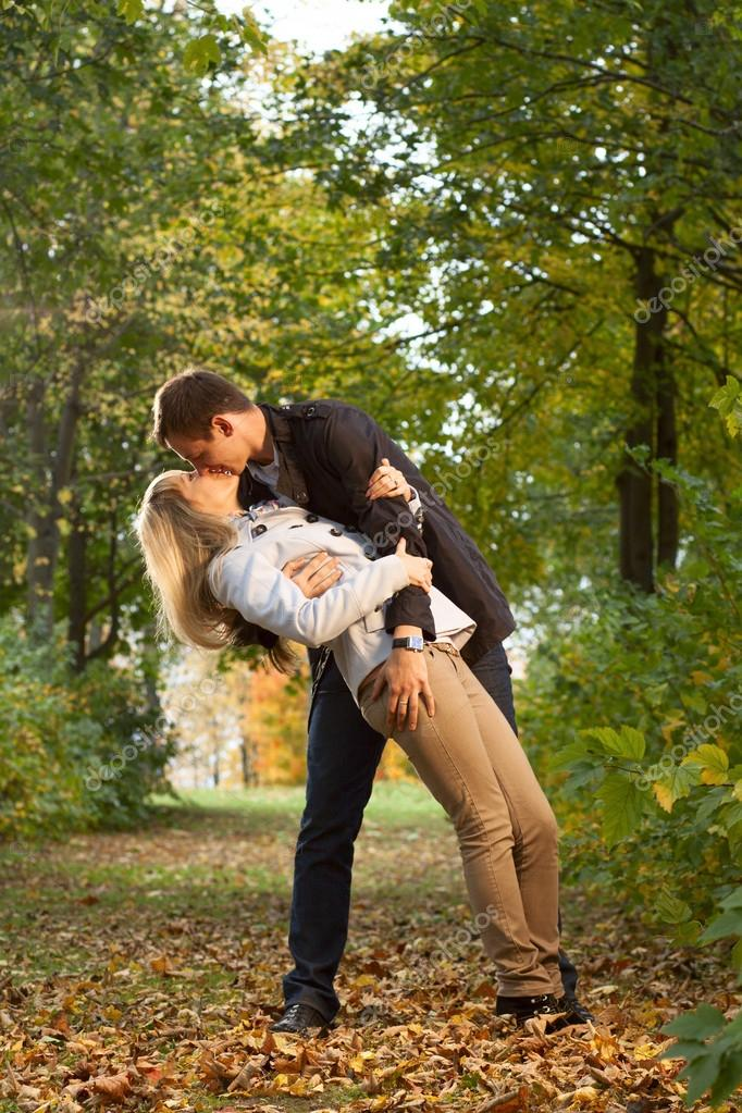 Romantic couple kissing in autumn park — Stock Photo #18668081