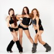 Three beautiful go-go dancers — Stock Photo