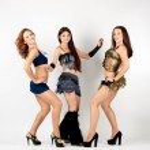 Three beautiful go-go dancers — Stock Photo
