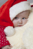 Cute Baby girl in christmas hat — Stock Photo