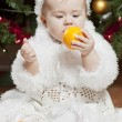 Stock Photo: Happy little baby girl playing with fruits