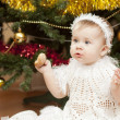 Happy little baby girl playing with fruits — Stock Photo