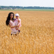 Mother holding her lovely daughter — Stock Photo