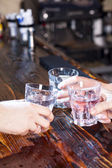 Hands make cheers with glasses — Stock Photo
