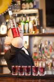 Professional barmen making cocktail — Stock Photo