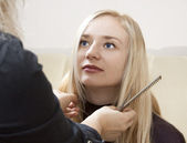 Hairdresser giving a new haircut — Stock Photo