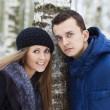 Happy Young Couple in Winter field — Stock Photo