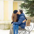 Stock Photo: Lovers kissing on bench