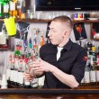 Professional barmen making cocktail - Stock Photo