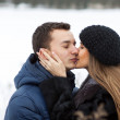 Happy Young Couple in Winter field — Stock Photo #22026625