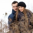 Happy Young Couple in Winter field — Stock Photo #22027613