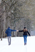 Couple walking in winter park — Stock Photo