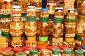Glass jars with nuts and honey — Stock Photo