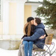 Stock Photo: Lovers kissing on the bench