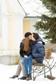 Lovers kissing on the bench — Stock Photo