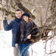 Happy Young Couple in Winter garden — Stockfoto