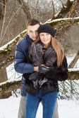 Happy Young Couple in Winter garden — Stock Photo
