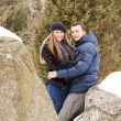 Happy Young Couple in Winter mountains — Stockfoto