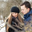 Happy Young Couple in Winter garden — Stock Photo #22303337