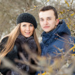 Happy Young Couple in Winter garden — Stock Photo #22303565