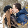 Happy Young Couple in Winter garden — Stok fotoğraf