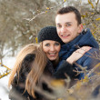 Happy Young Couple in Winter garden — Stock Photo #22304433