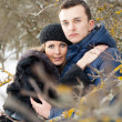 Happy Young Couple in Winter garden — Stock Photo #22304989