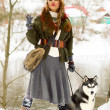 Happy young woman standing with siberian husky dog — Stock Photo