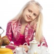 Little girl sitting at the table — Stock Photo