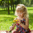 Little girl making a bouquet — Stock Photo