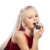 Girl biting a chocolate cake — Stock Photo
