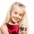 Surprised girl looking at cake — Stock Photo