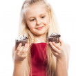 Girl making a choice between two cakes — Stock Photo