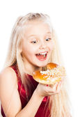 Girl biting a croissant — Stock Photo