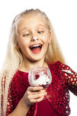 Beautiful blonde girl eating dessert — Stock Photo