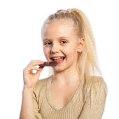 Beautiful girl with plate of chocolate. — Stock Photo