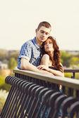 Beautiful young couple embracing — Stock Photo