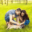 Young Couple sitting with dog — Stock Photo