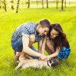 Young Couple sitting with dog — Stock Photo #25216621