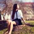 Beautiful girl sitting - Stock Photo